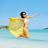Beautiful girl jumping on the beach Royalty Free Stock Image