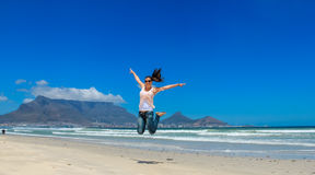 Beautiful girl jumping at Cape Town Stock Photo