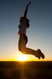 Beautiful girl jumping high in the air in spring morning Stock Images