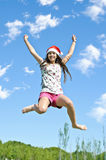 Beautiful girl jumping in the park Royalty Free Stock Photos