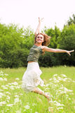 Beautiful girl jumping in park Royalty Free Stock Photo