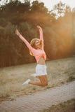 Beautiful girl jumping stock photo