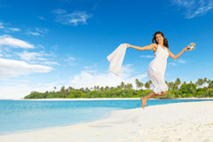 Beautiful girl jumping on tropical beach Stock Photography