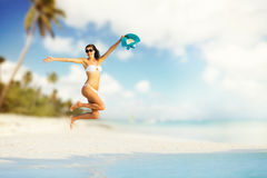 Beautiful girl jumping on tropical beach Royalty Free Stock Photo