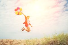 Free Beautiful Girl Jumping With Balloons On The Beach Stock Photos - 112797923