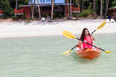 Beautiful Girl With Kayak Paddle  Travel and Vacation on The Bea Royalty Free Stock Photo