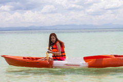 Beautiful Girl With Kayak Paddle  Travel and Vacation on The Bea Royalty Free Stock Photos