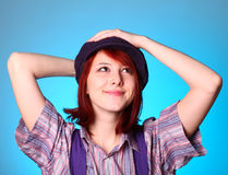 Beautiful girl keep hands near cap and smiling Stock Photo