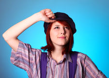 Beautiful girl keep hands near cap and smiling Royalty Free Stock Photography