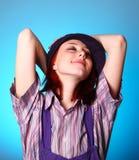 Beautiful girl keep hands near cap and smiling Stock Photos