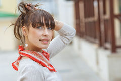Beautiful girl with kerchief on neck Stock Images