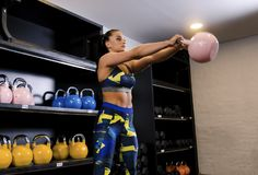 Beautiful girl and  kettle bell Royalty Free Stock Images
