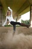 Beautiful girl kicking dust Royalty Free Stock Photography