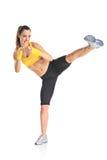 Beautiful girl kicking with the leg. Isolated on white background stock photo