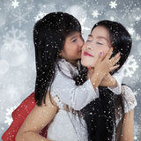 Beautiful girl kiss her mom with full love Royalty Free Stock Image