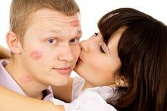 Beautiful girl kisses her boyfriend Stock Photo