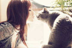 Beautiful girl kissing cat Stock Images