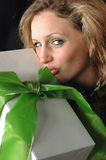 Beautiful girl kissing gift Royalty Free Stock Image