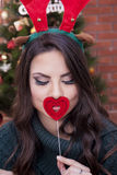 Beautiful girl. Kissing the heart royalty free stock photography