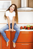 Beautiful  girl in the kitchen Royalty Free Stock Image