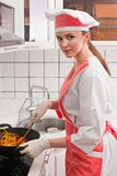 Beautiful girl in the kitchen. Stock Photography