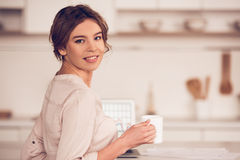 Beautiful girl in kitchen Stock Photos