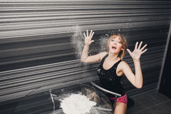 Beautiful girl the kitchen hands in flour Royalty Free Stock Images