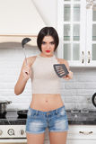 Beautiful girl in the kitchen. Royalty Free Stock Photos
