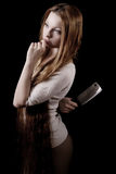 Beautiful girl with a knife Stock Photography