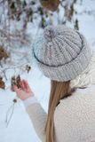 Beautiful girl in a knitted hat. For a walk in the winter forest Stock Photos