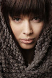 Beautiful girl with knitted scarf Royalty Free Stock Photos