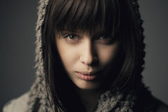 Beautiful girl with knitted scarf Stock Photos