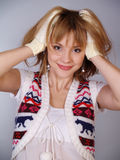 Beautiful girl in a knitted waistcoat Stock Photos