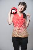 Beautiful girl with a ladybug smiling Stock Photos