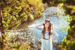Beautiful girl on a lake background. Portrait of a beautiful girl on a lake background in sunny day Stock Photos
