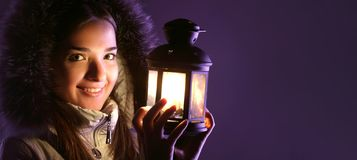 Beautiful girl with lantern. In winter royalty free stock photography