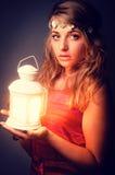Beautiful girl with lantern seeking Stock Photos