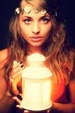 Beautiful girl with lantern seeking Stock Photography
