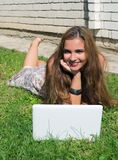 Beautiful girl with a laptop outdoor Royalty Free Stock Image