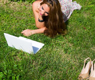 Beautiful girl with a laptop outdoor Stock Image