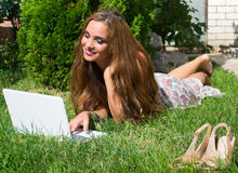 Beautiful girl with a laptop outdoor Royalty Free Stock Images