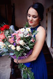 Beautiful girl with a large bouquet of flowers royalty free stock images