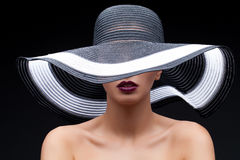 Beautiful girl in large hat Royalty Free Stock Images