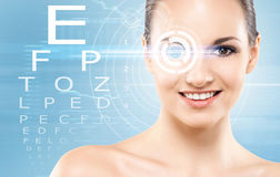 Beautiful girl with a laser surgery concept. Beautiful girl with laser surgery concept over blue background Royalty Free Stock Image