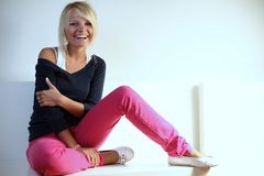 Beautiful girl laughing. Full body portrait of a pretty young blonde laughing woman Royalty Free Stock Images