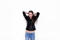 Beautiful girl laughing. Beautiful girl in black leather jacket laughs on a white background Stock Photography