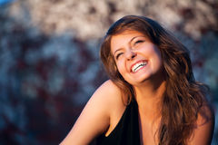 Beautiful girl laughs Stock Photos
