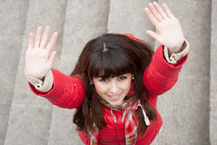 Beautiful girl laughs and raises her palms up Royalty Free Stock Photos