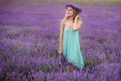 Beautiful girl on the lavender field. Beautiful blond girl on the lavender field royalty free stock photos