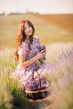 Beautiful girl on the lavender field. Stock Photos
